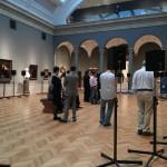 Museumgoers listen